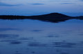 Stillness of twilight in northern sweden with river in the foreground Stock Photos