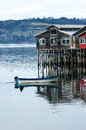 Stilt houses and boat in Chiloe Chile Stock Image
