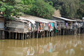 Stilt houses - was mirror in water-Cambodia Stock Photo