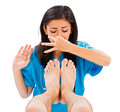 Stinky male feet female doctor holding her nose not to smell the man s isolated image Stock Image