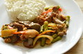 Stir fried chicken and mixed entrails with sweet chili eat couple with rice on dish