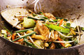 Stir fried chicken with vegetables as closeup in a wok Royalty Free Stock Image