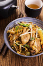 Stir fried noodles with chicken as closeup in a bowl Stock Photography