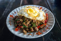 Stir fried pork with basil and egg on rice Royalty Free Stock Photo