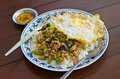 Stir fried pork with basil and egg on rice thai popular menu Stock Images
