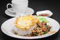 Stir fried pork and basil rice topped with with egg Royalty Free Stock Images