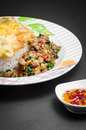 Stir fried pork and basil rice topped with with egg Stock Photos