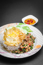 Stir fried pork and basil rice topped with with egg Royalty Free Stock Photos
