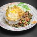 Stir fried pork and basil rice topped with with egg Royalty Free Stock Image