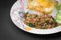 Stir fried pork and basil rice topped with with egg Royalty Free Stock Photography