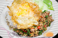Stir fried pork and basil rice topped with with egg Stock Images