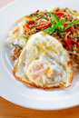 Stir fried pork and basil rice topped with with egg Stock Photography
