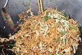 Stir fried rice noodle on the pan Royalty Free Stock Image