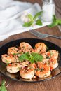 Stir-fried Shrimp with pepper and garlic on black plate. Royalty Free Stock Photo