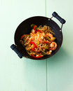 Stir fried shrimps in wok Stock Photos