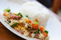 Stir fried vegetables and rice fast food with eggs as a main ingredient Stock Photo