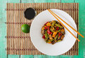 Stir fry with chicken, mushrooms, green beans and sweet peppers. Royalty Free Stock Photo
