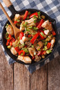 Stir Fry Chicken with mushrooms, peppers and zucchini on a pan c Royalty Free Stock Photo