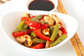 Stir fry chicken with sweet peppers and green beans Stock Photo