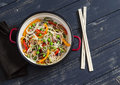 Stir fry vegetable with rice noodles in an enamel pot Royalty Free Stock Photo