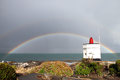 Stirling point rainbow a behind lighthouse at bluff new zealand Stock Image