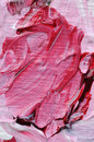 Stirred red colour and white on painting pallet Royalty Free Stock Photography