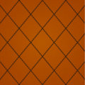 Stitched leather cross camel colored background Royalty Free Stock Photos