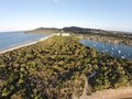 Stock aerial picture image of noosa spit photograph with hasting street one side and river the other with boats moored Royalty Free Stock Photography