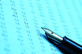 Stock chart pen on business concept blue tone Royalty Free Stock Photo