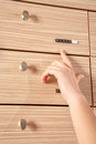 Stock drawer and a hand showing it Royalty Free Stock Images