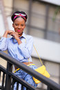Stock image fashion model posing smiling on a stai photo jamaican staircase and Royalty Free Stock Photo