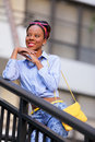 Stock image fashion model posing smiling on a stai photo jamaican staircase and Stock Photo
