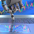 Stock market robot trading hand ordering on a laptop keyboard an exchange trade system is a computer program that automatically Royalty Free Stock Photo