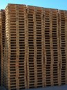 Stock of new wooden euro pallets at transportation company stocked Stock Photos