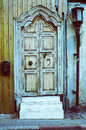 Stock photo of an antique grunge door entrance with lantern and Royalty Free Stock Photography