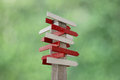 Stock photo blank wooden signpost with many arrows wood direction sign on green background Royalty Free Stock Images