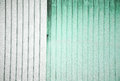 Stock Photo of a Corrugated Metal green and White Background Royalty Free Stock Photo