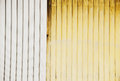 Stock photo of a corrugated metal yello and white background Royalty Free Stock Photos
