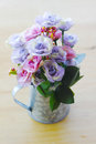Stock photo fake hydrangea flowers in zinc watering can on whit wooden Royalty Free Stock Photos