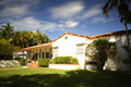 Stock photo of a 1950`s house with blurry clouds Royalty Free Stock Photo
