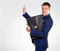 Stock photo thumb up successful businessman with a briefcase Stock Photo