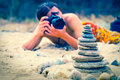 Stock photographer take pictures of stone pyramid Royalty Free Stock Photos