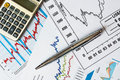The stock price to calculate and write the result graphic with calculator on table Royalty Free Stock Images