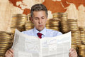Stockbroker a businessman reads the finance newspaper Royalty Free Stock Image