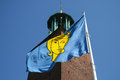 Stockholm city hall and coat of arms of stockholm flag flying on sweden Royalty Free Stock Image