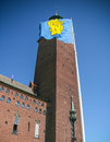 Stockholm city hall and coat of arms of stockholm flag flying on sweden Stock Photography