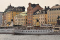 Stockholm old towm and steamboats sweden harbour traditional gamlastan city quarter Stock Photos