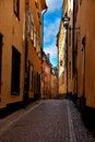 Stockholm: portrait of narrow street on Gamla Stan Royalty Free Stock Image