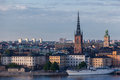 Stockholm riddarholmen church the long tower of and the historical buildings of downtown sweden Royalty Free Stock Images