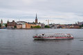 Stockholm Sightseeing Boat With Cityscape in Background in cloud Royalty Free Stock Photo
